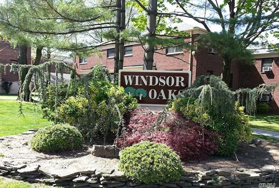 Windsor Oaks. The larger unit on 2nd floor, recently renovated Kitchen and bathroom, two bedroom. Washer/dryer in the unit. Free 2 parking spots. Income Required: $50K for one person, $75K for 2 person. Sublease after 1 year, 100% Equity, No Flip Tax. Dogs and cats welcome. School District 26. Close to bank, supermarket. Local buses and Express buses to NYC.Buses: Q27, Q88, Exp Buses: QM5, QM35 to Manhattan