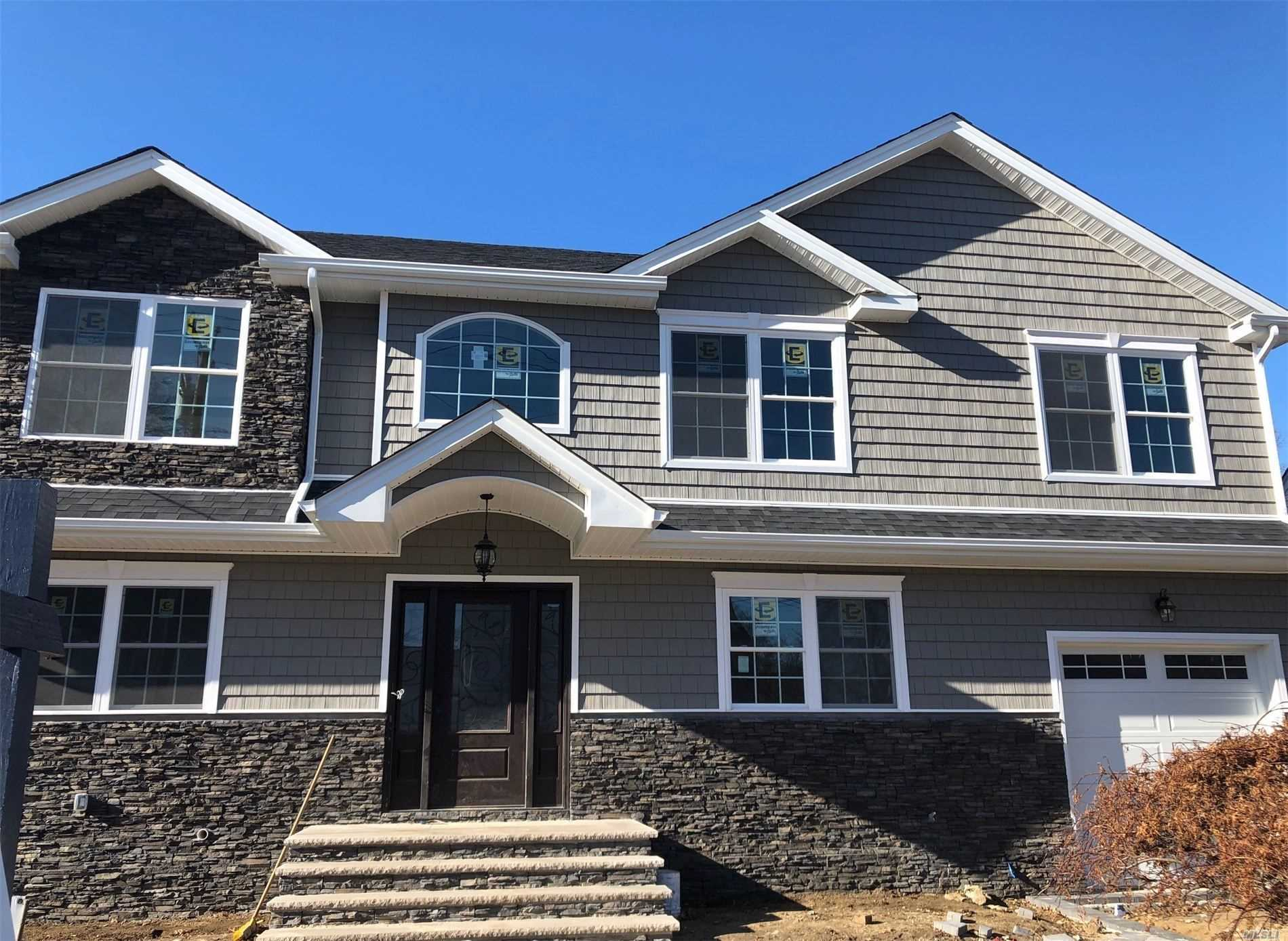 Beautiful New Colonial boasts 5 bedrooms, 3.5 Baths, Living Room, Formal Dining Room, Den , Laundry Room, Full Finished Basement, Cac .