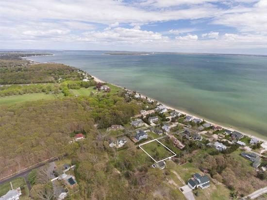 This prime lot in charming Camp Mineola is just 1/10th of a mile from a private beach and minutes from Love Lane, LIRR, Hampton Jitney and all Mattituck has to offer. The lot is cleared with approvals in place so come with a plan to build your North Fork dream house in this classic beach neighborhood. Deeded beach rights and Strong's Marina just yards away for your boat.
