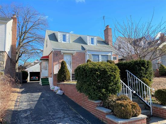 Large Expanded Cape In Prime Fresh Meadows Location. 4 Bedrooms, 2 Baths, Formal Living & Dinning Room, Sitting Area On Second Floor, Finished Basement. 27X41 Building Size, 40X100 Lot, 2 Car Garage, Great For Large Family. Walk To Union Turnpike, 188 Street To shops And Express Bus To Manhattan.