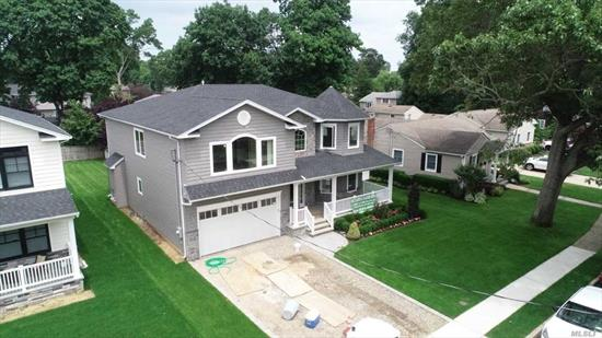 Spectacular Brand New Custom Built 5 Bedroom Colonial. Must see to Believe All Top Of The Line Designer Showcase!!! In the Heart of Wantagh Woods ******Immediate Occupancy***** Turnkey Move Right In!