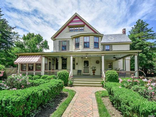 FULL of CHARM with modern updates in GREAT location. This SUNNY Victorian with it's large wrap around porch, makes you feel right at home. Modern comforts such as CAC, whole house generator, sprinklers & security system keep this home up to date. There are 5 bedrooms with 3 full baths. There are many options for flexible living situations. But who can resist the moldings, columns, slate roof, painted lady exterior, outdoor fireplace, indoor fireplace, vintage wood floors!!! NS schools.