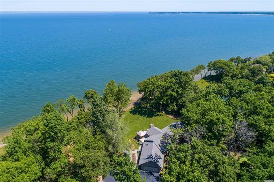 Waterfront Residence Sits Directly On The LI Sound W/ DIrect Access To The Beach! This Beautiful 4 BR, 3 Full Bath Ranch Has A Serene & Picturesque Setting, Warm and Inviting With A Stunning Great Room W/ Fireplace, Walls of Windows, Newly Updated Kitchen, Wood Floors & Full Finished Basement. Perfectly Situated on 2.15 Acres of Property W/ 168 Ft. Of Beach Frontage. Owners Installed Brand New Staircase To The Beach Below, Erosion Protection Structure, Sea Wall/Rock Revetment And Bulkheading.