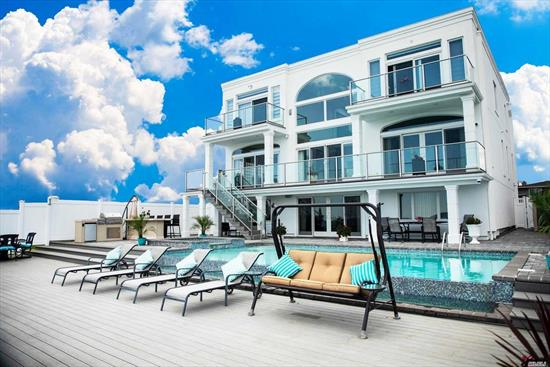 Are you used to the best of everything? Then this is your next residence! Experience waterfront living and entertaining like no other home offers. Hamptons at half the distance and half price! 45 min by train to Manhattan and Brooklyn, award winning school district #25, grandeur of extra high ceilings and imported designer features perfectly matched and coordinated. Entertain in 5 star style with infinity saltwater pool/jaccuzzi, or indoor home theater and a wetbar. Master suite wing!zone x