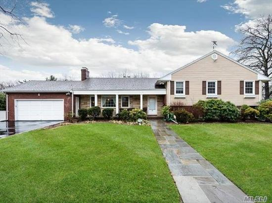 SPACE + VALUE GALORE!! 4 BR, 3.55 BATH Split Level on 100 x 150 Lot on beautiful street. Large Entry Foyer, LR/FP, FDR, DEN/PR, Ultra-modern EIK with Garland Gas stove and 2 skylites, 4 Bedrooms and 2 Baths on 2nd floor. Large Playroom on Lower Level with PR PLUS 2 BONUS Rooms and full bath plus storage. Immaculate Sub-basement with mechanicals and heating and massive amounts of space. 2-car garage. 4360 SF incl. sub-basement and garage.  (Total Taxes include GC Village Tax). GENERATOR!!