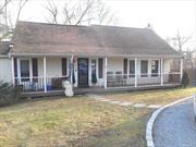 Just a great house! Front porch leads to an oversize entry Foyer. The large kitchen with updated appliances features an impressive center Island for sitting and entertaining and has a nice pantry. Living Room with fireplace and dining area, with siding glass door to deck overlooking yard. The 2nd floor has 2 large bedrooms and full bath. The property goes street to street for parking in circular driveway or in the back.