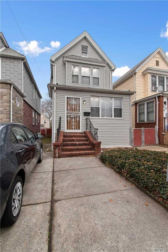 Beautiful detached colonial located near Forest Hills Gardens. Completely renovated house w/a sun-drenched living room, formal dining room, updated kitchen w/high end appliances, laundry & powder room on 1st floor. The 2nd floor features 3 bedrooms and a full bath. The house also has a finished basement and attic. Exit to a private backyard and driveway. The house is located between Metropolitan Ave and Austin St. Close to subways, LIRR, major highways, airports, shopping, restaurants, and parks