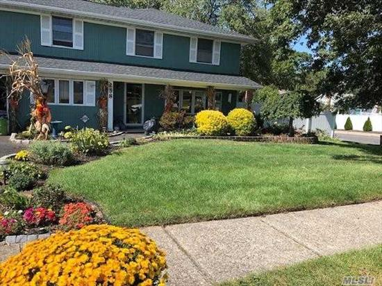 Beautiful expanded Colonial in Sachem SD. Large 5 bdrm, 3.5 bth with bonus room & own ose & permit. Entrance & Fdr w/porcelain floor, Eik w/granite and double oven w/convection, Den w/sliders to yard. LR has newly finished hdwd, new railings. Brand new cac, 5 yr old roof, new 200 amp, new carpet & paint. Very low taxes, pvc fenced, perennial lined property with 20x40 deck (gift) patio & covered porch. 2 sheds, belgian block lined priv driveway, 1 car garage. Must see. Won't last.