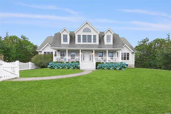 South of Highway Westhampton, down private flag lot, enjoy the ultimate Hampton's Home. Open floor plan with great room, fire place, chef's kitchen and formal dining area. Additional den and game room lead out to expansive deck and heated pool. First floor master suite, and additional guest suite., Second floor Jr Master, 2 guest beds and bath. Har Tru tennis close to Westhampton Village, and ocean beaches.