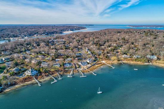 Coastal Living At Its Finest! Pristine, Bright, Move-In Ready Completely Renovated 4 Bdrm/3 Bath Colonial W/Waterviews & Boat Strip Across the Street. Open Floor Plan W/Chefs Kitchen , White Quartz, SS Appliances, Grand Family Rm, Dining Rm, Living Rm, Luxurious Mstr Suite W/Expansive Dressing Rm/Huge Closet, Gleaming HW Floors, CAC, All New Siding, Windows, Roof, Boiler, W/D, Finished Bsmnt, Expansive Deck W/Spectacular Waterviews! Harborfields SD! Private Sea Spray Boating Assoc. W/Dues.