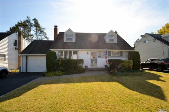 Wonderful Cape Cod with Room For Extended Family! Ef, Lr/Gas Fpl & Bay Window, Fdr, Eik w/Sliders to Yard, Den, Mstr Bdrm w/Huge Walk in Closet, Full Bath w/Handicap Shower and Separate Tub. Hardwood Floors Throughout. 2nd Floor; 4 Large Bdrms, Full Bath. Central Air on the Second Floor, 2 Units on the First Floor. Full 1/2 Finished Basement w/Rec Rm, Laundry & Utilities. 2 Car Tandem Attached Garage. Private Yard w/Patio.