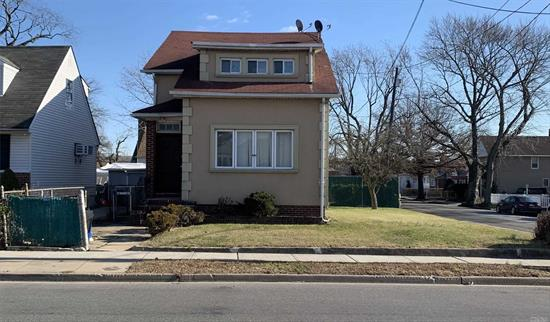 Excellent updated 2 family home.  Vacant and ready to be moved into. Spacious corner property with a private driveway fitting 2 cars and a 1 car garage. Nice hardwood floors. Boiler is 5 years new!