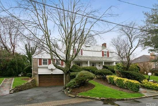 First Time On The Market. SPACE + VALUE GALORE!! 4 BR, 3.5 BATH Center Hall colonial on an over sized Lot and Quiet beautiful street. Large Entry Foyer, LR, FDR, Beautiful DEN/PR, 1 B/R and Full Bath on the first floor, EIK with Gas stove and, 3 Bedrooms plus 2 Baths on 2nd floor. Large sun-room on the Lower Level .Hardwood Floors, basement with mechanics, heating and massive amounts of space. 2-car garage. Close to LIRR/Bus/Hwy. Ideal Location, Low Taxes. Room To Add additional B/R and Baths.