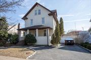 Best Deal in Bellmore!! One of a kind Colonial with 4 Floors of charmed living space. 9 ft ceilings on the first floor. Huge Kitchen (updated). Master Bedroom w/ a walk-in closet. 3rd floor has 2 rooms and a bath. Near town and railroad. SD 7. Kennedy High School.