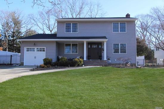 Located In A Court This Fabulous Colonial Boasts A Spacious Floor Plan, Updated Maintenance Free Roof and Vinyl Siding Exterior, Living Room, Formal Dining Room, Updated Eat In Kitchen, Two Updated Baths, Updated Windows, Updated CAC, Updated Gas Heating, Updated Hot Water Heater, Hardwood Flooring Throughout, Amazing Fenced Yard, 200 Amps, Lofted Garage for Additional Storage, Full Basement. Too much to mention! Enjoy Tour & Floor Plan!