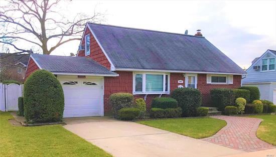 Beautiful cape located in the northern section of Franklin Square. First floor offers Updated Kitchen, FDR, LR, Den, Hall Bathroom, 2 Bedrooms and 1/2 Bath. Second floor offers 2 Bedrooms. Finished basement and attached 1 car garage. Home situated on beautiful 6080 square foot lot.