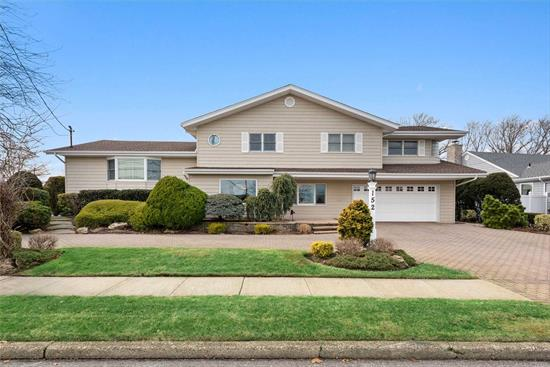 Don't Miss Out On the Opportunity To Own This Amazing Entertainer's Paradise in Bar Harbour!. Beautiful Waterfront Expanded Split offers an expansive den w/heated porcelain tiled floors, French doors open into the 3 season room w/gas fpl. Upstairs enjoy open floor plan LR, FDR, & large kitchen w/heated wood floors. Master bedroom suite has a 12 X 10 walk in closet, marble bath, dual sinks & dual walk in shower. 2 Car Garage, Finished Basement, CAC, IGS, IGP , Multi tiered Decks with Pergola.