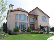 Masterfully designed with expert craftsmanship. with a dramatic 2 story Entry. This turnkey Colonial features many upgrades from interior to exterior granite flooring throughout the first floor and master bath with radiant heat. Huge rear decks made from Brazilian Ipe Gated Property with koi pond room for a pool. Red barrel roof with custom detailing to chimney. with much attention to detail custom moldings through out .Superbly done chef's appointed kitchen, one block to the beach...