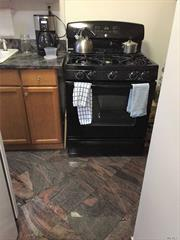 Largest 2 Bedroom, 5 Room Upper Corner Beauty Drenched in Sunshine, Fully Renovated Kitchen Featuring Marble Tiled Floors, Granite Counter Tops, Beautiful Hardwood Floors, Updated Bathroom Steps to Attic, 24 Hour Security. Close To Shops and Transportation, Schools