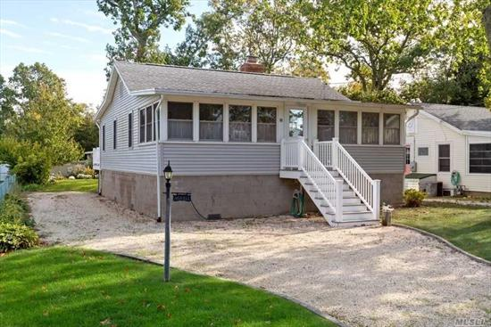 Welcome to your beach getaway! This lovely 3 BR home has a private beach at the end of the street to enjoy sunny summer days. The home has an enclosed 4 season front porch, Living room w/fplc, kitchen, formal dining area and trex deck for entertaining. Property has 2 out buildings, 1 for storage & the 2nd is shower w/hot & cold water & changing area. Home was completely renovated 7 years ago. Come enjoy all the North Fork has to offer!