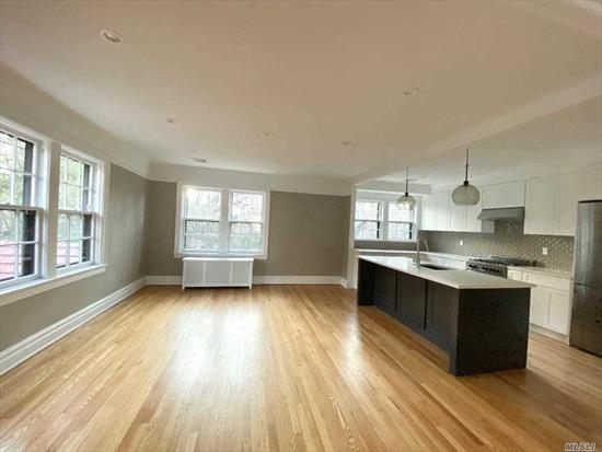 Semi-Attached duplex 2 &3 floor. Newly renovated open concept kitchen dinning room. Living room w/ fireplace. 3 bedroom 2 bath, washer & dryer , 1 car garage space. Located in the magnificent Forest Hills Gardens.