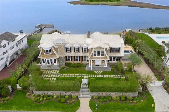 Stunning 6100 sq. ft. traditional post modern in prime location between the bridges. Sweeping bay & ocean views from every room & spacious floor plan. Offering 1st floor living room with fireplace, chef's eat-in-kitchen, butler's pantry, formal dining room, theater, study, & office/bedroom. 2nd floor with 2 master suites with spa baths/showers, 4 guest en-suites & Gym. Expansive terrace with heated gunite pool, spillover hot tub & waterfall. Personal bay dock & private ocean access across road.