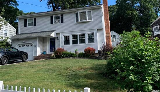 Pristine Colonial Set On .12 Acre In Hunt. Sta. Hardwood Floors Throughout. Updated Large EIK w SS Appliances. LR With Huge Window & Fireplace. Cozy Den W Sliders & Fireplace Off Kitchen. Formal DR.Updated 1/2 Bath. 2 Updated Baths Upstairs. Two Bedrooms. & MB w Large WIC & Vaulted Ceilings.Spacious Flat Backyard, Great For Entertaining. Loc Convenient To Shopping, Parkways, and LIRR. Bosch Hot Water Gas Boiler. Move-In Ready.