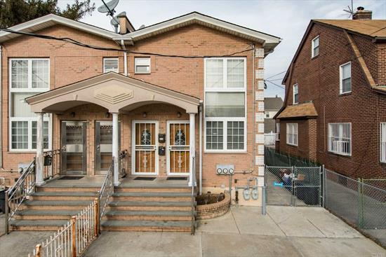 Young 2006 2 Family brick semi att w/sep entr's for both apts, both feature HW fls, granite cnters, cherry wood & oak cabinets, finished basement w/high ceilings & OSE, large Garage, recent new hot water heaters & CAC,  main fl apt features Mstr BR w/Mstr Bth, another BR& Bth, Kitchen, Formal DR, LR & stairs leading up to beautiful Loft for office/reading etc. 1 BR apt has sep ent & hallway, lge EIK, BR, LR & Full bth, Great 2 family and/or investment near all trans, exp to NYC, Airports/parks