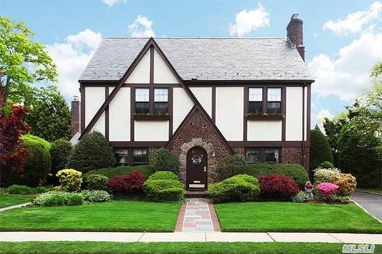 Stately Tudor In Tne Adelphi Estates. Cathedral Ceiling Family Room With Skylights W/Fp Off Kitchen, Large Living Rm W/Fp, Formal Dining Room, Grand Entry, Sun Room. Upstairs There Is A Large Master Suite, 2 Large Bedrooms W/ A Jack And Jill Bath And A Private Guest Suite With Its Own Staircase And Bathroom. A Must See!