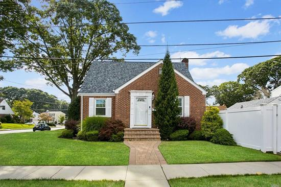 Modern Four Bedroom 2.5 Bath Conveniently Located Minutes From Highway & Half Mile From LIRR, Low Taxes, Full Half Finished Basement With Legal Half Bathroom & Outside Entrance, Brick Spacious One Car Garage, Privacy Fence, New Windows, New Roof, Gas Cooking, Wont Last!!!!!