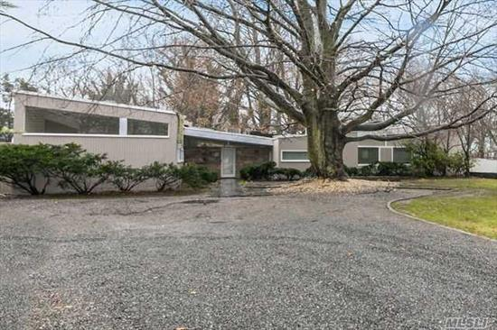 Contemporary home built by famed architect Marel Bruer. Sits on 1.1 acres of park like property. pool is 20x40 with deck and screened in porch. guest house on property includes 1 BR, 1FB, LR and efficiency kitchen.