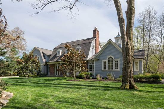 Beautiful, Custom Designed & Built Shingle Timber-Frame Hybrid-Style Residence. Detailed Millwork W/Exceptional Truss-Work & High-End Finishes. Expansive, First-Floor Master Suite Offers Views Of The Magnificent Estate-Like Grounds W/Lush Gardens & Stone Walkways.Fabulous Windows Provide An Abundance Of Natural Light. Bedroom With Large Sitting Room on the 2nd Level Can Be Redesigned to include a Third Bedroom. Charming Studio/Recreation Bldg. CSH SD#2, Lloyd Harbor Park & Beach (Dues Required)