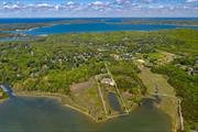 Come see this one of a kind Sprawling Beach House situated on 3.5+acres of Waterfront Privacy, elevator, 5+BR, 5.5BA., Gunite Heated Pool. Stunning waterfront views from every room, creek to bay access. This is a fantastic buy