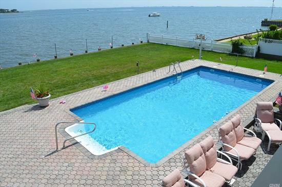 Pristine Open Bayfront Home in the Heart of The Hamptons w/4 Spacious Brs, 3 F.Baths, Liv.Rm, Updated EIK, Din.Area, Huge Family Rm/Den, Porch, IG Heated Pool, Hot Tub, Outdoor Shower, Newer 100'Bulkhead, Generator, Natural Gas Heat, Alarm System, Shed. In Prestigious Tiana Shores Private Beach Community W/Sandy Beach, Pool, Tennis & Clubhouse. Minutes to Ocean & Bay Beaches. By Appointment Only.