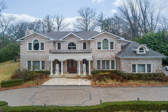Palatial and Majestic Center Hall Brick Colonial Situated On 1Acre Property Featuring Formal Lr W/ Fireplce, Dr, Den, Library, State-Of-The-Art Eik Maid's Room + Bath, Laundry Rm. 2nd Flr hosts Master Bedroom Suite W/Bath , 4 Large Family Bedrooms & 3 Full Baths, Bonus Room. Full Finished Basement W Spa & Theater, Central Vac. Large Swimming Pool. 3 Car Garage.
