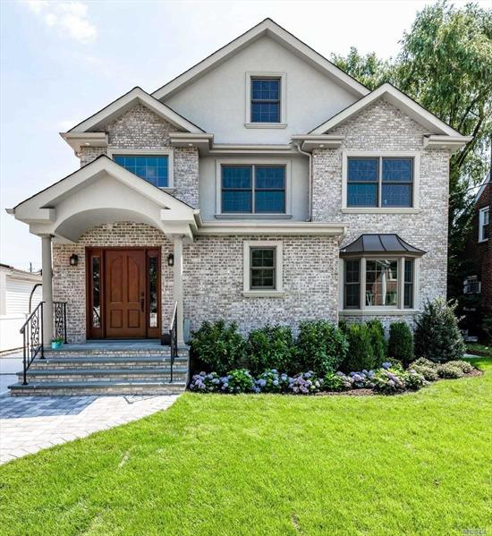 New Brick Colonial With 4 Bedrooms, 3.5 Baths. All High End Finishes, Parquet Floors, Hw Throughout. Open Concept, Country Kitchen, Living Room, Dining Room, Family Room. Finished Basement 8' Ceilings 2-Car Garage. Must See!