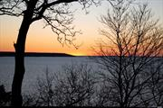 Beach Front Entertainer's Delight! Picture Yourself On A Panoramic Bluff Overlooking The Picturesque LI Sound With Private Beach & Mooring Rights. Enjoy Phenomenal Sunset Views On The 35x45 Sundeck. This 4Br/3Bth Post And Beam Custom Built Home By Deck House Is A Unique Waterfront Ski Chalet In The Woods. Features Mahogany/Granite Kitchen, Walls Of Glass, Stone Fireplace & Private Guest Suite W/Separate Patio. Flood Insurance Not Required. This Is The Home You Deserve!
