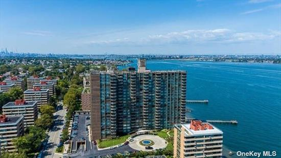 Beautiful renovated 2 bedroom/2 bathroom apartment. New kitchen and bathrooms in this spacious unit. Wood floors throughout and great closet space.  Heated in ground pool, recreation room and gym. 24 hour Doorman , valet parking and security in this gated community. Laundry room on each floor. Gorgeous grounds on this waterfront property.  Ready to move in and enjoy the water view from the terrace.