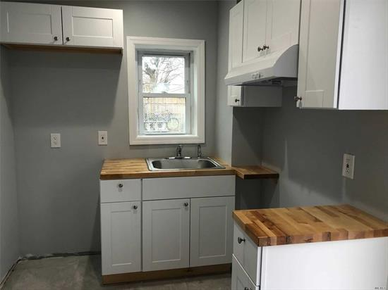 Studio mint freshly painted, new kitchen and bath new stove and refrigerator, tile flooring, large closet, parking included