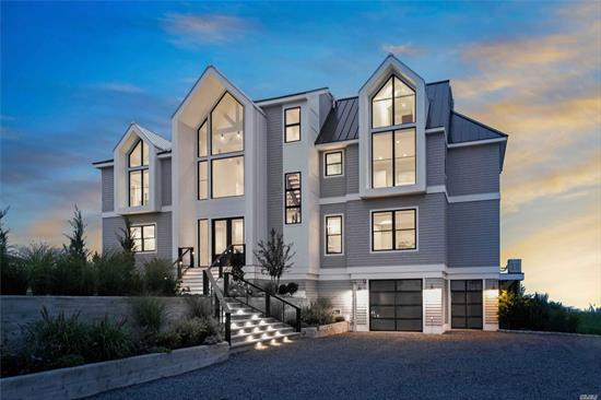 Sitting at the edge of the water, this modern new construction home offers stunning views overlooking the bay! The foyer's 30' ceilings open into your open living area. A Chef's kitchen with a Gaggenau gas cooktop and Teppanyaki griddle, refrigerator, freezer, wine fridge, and dual dishwashers. Second floor master bedroom suite offers a modern oasis inside the home. Entertain on your bayside deck and relax in it's heated saltwater Gunite infinity pool with spa. The sunsets are second to none!!
