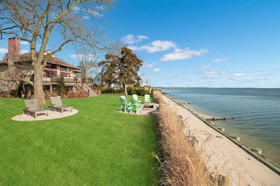 Open Floor Plan Bayfront, Completely Renovated in 2016! Over 100 Feet on the Peconic Bay with Panoramic Views. Double Bulkheaded with Sand, Fire Pit and Large Deck... Plenty of Out Door Entertaining Space. Inside Has a Bi Level Open Living Room/Dining Room with Fireplace, Lots of Natural Light and Hard Wood Floors; Kitchen with Stainless Steel Appliances and Quartz Counters. Main Floor has a Master Suite, Above is a Loft Master Suite.  Close to All the North Fork has to Offer.