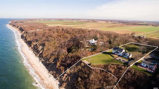 Looking For A Peaceful Retreat? Come Out To The North Fork Now To Tour This Property On The Bluff Overlooking The Long Island Sound. It Is Ready For You To Add Your Own Ideas And Special Touches To Make It Uniquely Yours. This Grand Property Is Over Two Acres With A Gated Drive And In ground Swimming Pool Where You Can Drink In The North Fork's Famous Sunsets. Panoramic Views Of The Sound Create A Hypnotic Atmosphere As You Sit And Watch The Boats Go By, The Waves Roll In & The Seagulls Fly.