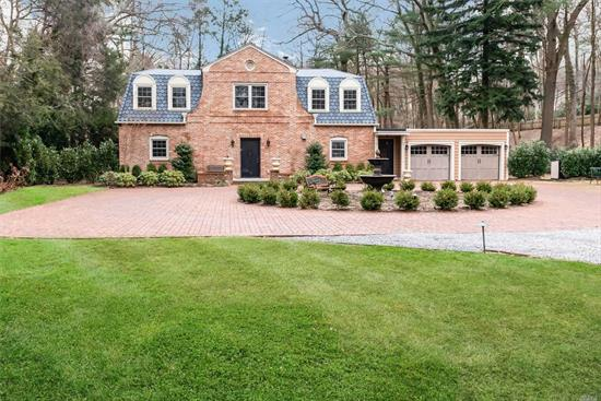 Old world charm meets todays latest amenities and conveniences. Enter the circular driveway through private estate gates into a picturesque setting. The property is lush and spectacular and compliments this exquisite brick colonial. This home has been totally renovated - everything is new and top of the line. You must see this in person to truly appreciate this stunning home and the tranquil European gardens that surround it.