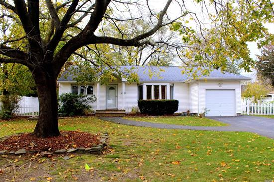 Charming tree-lined Mayfair Estates. Near to all Shopping for which Commack is famous. All new Maple kitchen cabinets with Quartz counters, and beautiful tile backsplash, New Full Bath with Laundry chute,  Andersen Windows & Slider,  New Roof and Siding, Gleaming Wood floors throughout (except the Den) Porcelain tile in the Kitchen and Bath. Huge Basement, Walk-in Cedar Closet, Large rear Trex deck, Storage shed. Very large private back garden. Charming quiet neighborhood. Move right in.