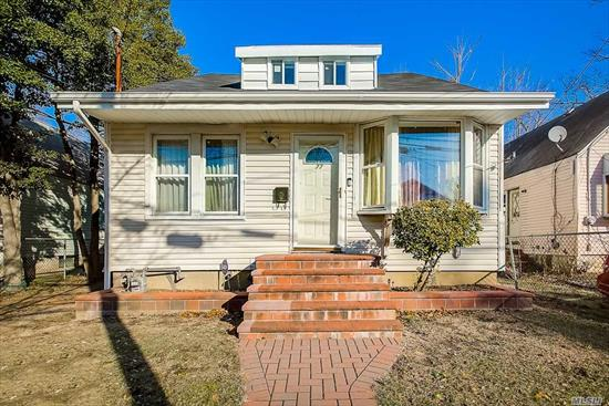 Spacious Expanded Cape With Open Floor Plan. Upper Level Is 24 x 20 With Large Closet. Finished Lower Level With Fireplace And Separate Outside Entrance. Gas Heating, Updated Electric, 1 Car Detached Garage. Beautiful Deep Yard. Near All ! Won't Last !