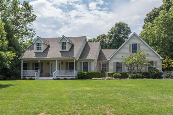 Exceptional 3Bdr 2.5 Bth Cape In North Fork Wine Country, Features Open Flr plan, Custom Eik w New Fridg & Microwave , Mster Suite w Walk In Closet & Full Bth, Spacious Fdr, Den w/Fp, Cac(2 New Compressors & Air Handlers 13 Ser), Hw Flrs, Fin Bsment W/Theater Rm, Den/Play Rm, Framed Walk Up Attic Suitable For 4th Bed Rm Suite, Country Club Yard W/Fire Pit Over Looking The Mt Lake Pool W/Flowing Waterfalls & New Liner, New Garage Drs, Private Landscaping, Brick Patio, Owned Solar Panels, Min to Beach & Farm Std
