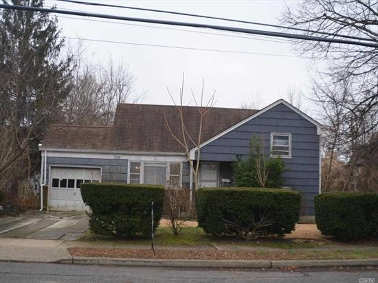 WHY RENT!!!! Very LOW Taxes!! Wide Line 3 bedroom Split level home located in the Plaza elementary school district and blocks from the LIRR