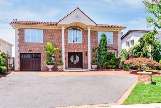 Stunning and Elegant Open Bay Splanch Boasts 4 Large Bedrooms with Exquisite Details Throughout. Enjoy Magnificent Sunset Views of the Open Bay, Huge Gourmet Chef's Kitchen w/Center Island , Wolf Appliances, Hot Tub, New Roof, Bulkhead and Pier, 3 Full Baths, Oak and Granite Floors w/Radiant Heat, Laundry Rm, Venetian Stucco Walls, Gorgeous Custom Staircases, Dental Moldings, Boat and Jetski Lift. There is a Fabulous Outdoor BBQ, Firepit, Pergola, Central Vac, Alarm System/ Move Right In!