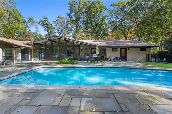 Gorgeous sun-drenched 5 BR 4 1/2 BTH California style exp ranch w/open layout sited on 3 secluded acres. Chef's kitchen complete w/Wolf, Sub-Zero appliances & butlers pantry opens to Vaulted Great Room w/lg stone FPL & office closet overlooking heated pool. Fml Living room w/stone FPL. Fml Dining w/tray ceiling. Spacious Master Suite boasts patio access & huge Walk-in shwr/bth. Lwr lvl features movie theater & guest apt suite with grd level ent & prkg. Front/back estate ent. Your retreat awaits!