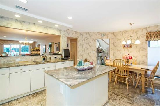 Redone Crossfield overlooking the pond, featuring an opened kitchen with stainless appliances, wood floors in Living/Dining Room, main floor Family room, tubed skylights in upper hall, redone baths in a choice location with Evergreens surrounding the rear deck.